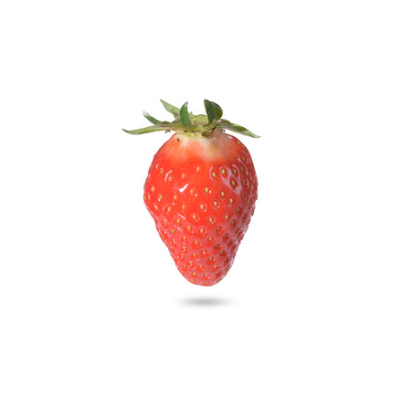 potassium: Close-up of a ripe strawberry, natural source of vitamin C, potassium and antioxidants, with shadow, on white background Stock Photo