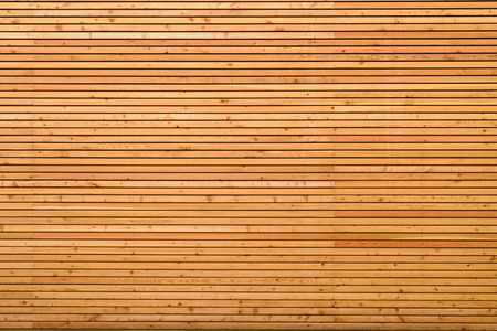 Background texture of finely slatted natural brown wood in a parallel pattern used in building decor and construction Archivio Fotografico