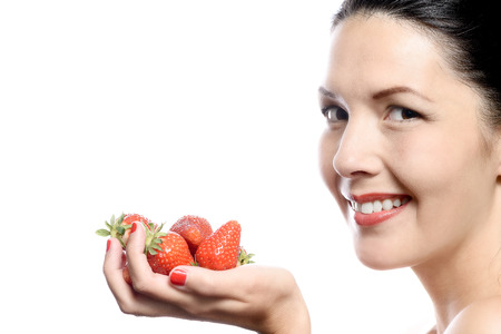handful: Smiling Woman with Strawberries in her Hand on white background.