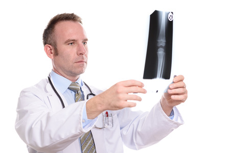 orthopaedic: Radiologist or orthopaedic surgeon examining an x-ray of a joint as he checks on the progress of the patient or tries to reach a diagnosis isolated on white