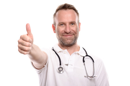 Happy male doctor giving a thumbs up gesture to show that surgery or treatment of a patient has been successful and there is hope for a full recovery, isolated on white