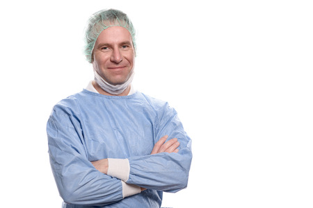 hospital gown: Friendly male nurse or doctor in surgical scrubs wearing a theatre gown, mask, goggles and a cap looking directly at the camera, head and shoulders isolated on white Stock Photo