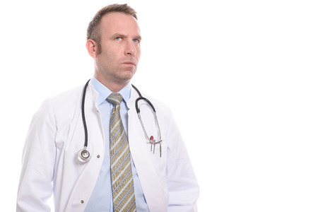 Serious concerned middle-aged male doctor staring thoughtfully up into the air as he considers his options over a problem patient isolated on white photo