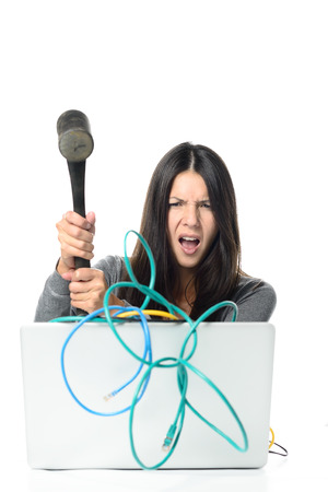 Angry Woman Smashing Her Laptop with Tangled Network Cables Using Large Hammer. Isolated on White Background.