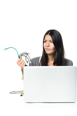 Close up of Upset Woman in Gray Long Sleeve Shirt holding Tangled Network Cables in Her Hand While Experiencing computer problems, Isolated on White Background. photo