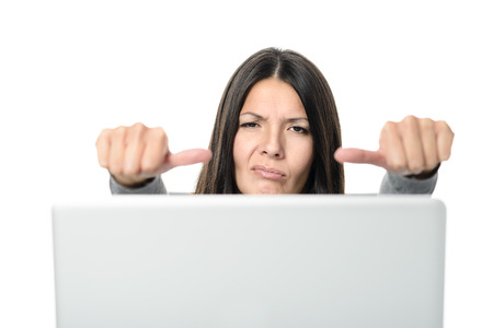 malcontent: Unhappy Young Woman with Laptop Showing Thumbs on Sides Signs, Emphasizing Unsatisfactory. Isolation on White Background.