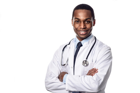 lab coat: Attractive confident male African doctor wearing a white lab coat and stethoscope looking at the camera with a happy expression, upper body isolated on white