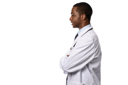 half body: Half Body Shot of an African Male Doctor in Side View, Facing to the Left of the Frame with Arms Closed, Emphasizing Copy Space, Isolated on White Background.