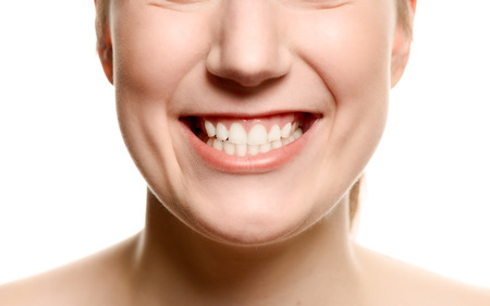 maxilla: Close up of the mouth of a smiling woman showing her teeth in a dentistry, oral hygiene and healthcare concept, isolated on white Stock Photo