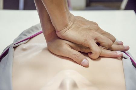 chest compression: cpr training Stock Photo