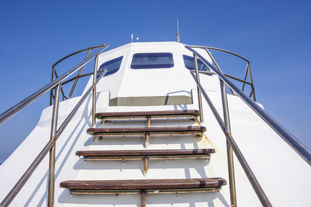 staircase on prow at noontime Stock Photo