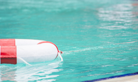 ring buoy floating in the pool close up half each