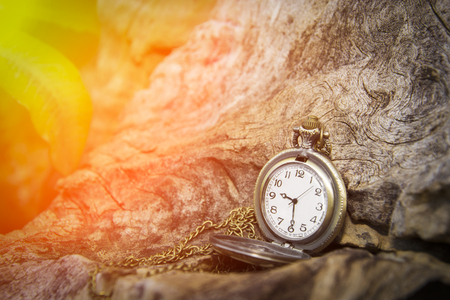watch locket on the wooden table  bokeh background and flare Stock Photo