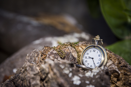 watch locket on the wooden table dark background