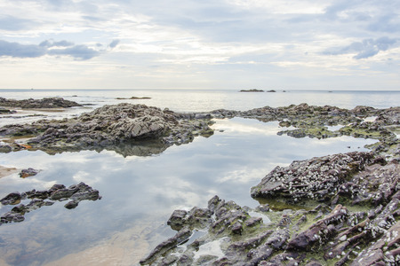 seascapes: rock on the beach and cloud in sky blue natural seascapes morning time