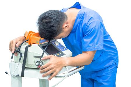 doctor hold EKG monitor and stethoscope on machine isolated