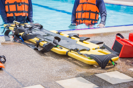 long spinal board for rescue on the floor pool Standard-Bild