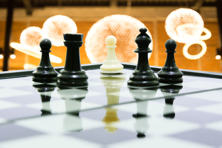 pawns: one white pawn on king shadow fight team black chess concept business leadership and teamwork Stock Photo