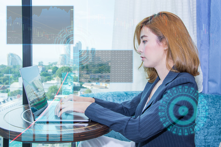 female business asia use laptop worker stock market data