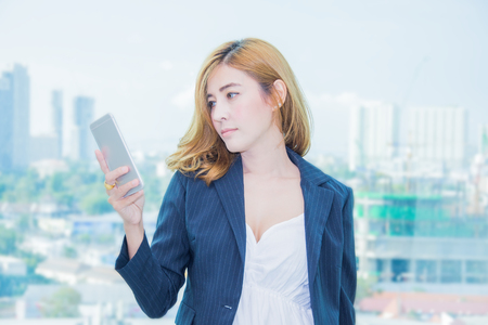 portrait asia business women hold telephone conection people Stock Photo
