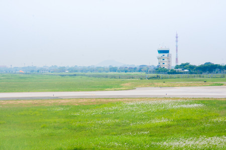 aeronautical tower cotrol air plane and green meadow Stock Photo