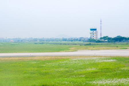 aeronautical tower cotrol air plane and green meadow Фото со стока