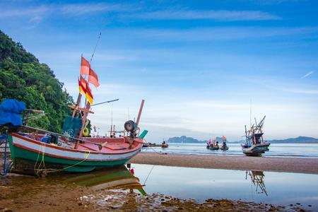 Fishing boat near moutain natural seascape sky blue Stock Photo
