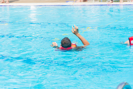 people drowning show two hand victim in the pool water Stok Fotoğraf