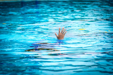 victim drowning show hand ask for help