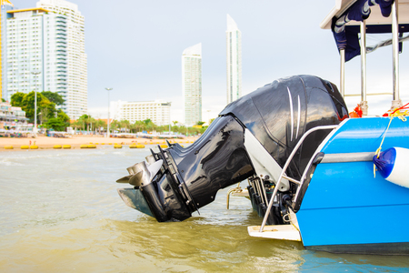 Speed boat parked on the beach.close up boat engine Stock Photo