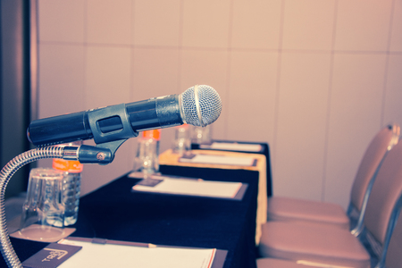 Close-up of retro microphone at meeting room