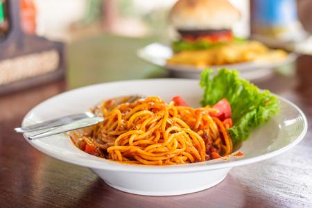 spaghetti italian food in the dish on table