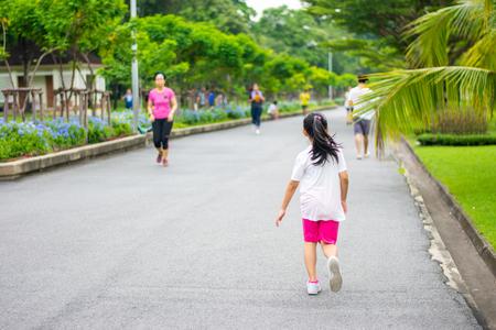 Asia little girl running in the garden Stock Photo