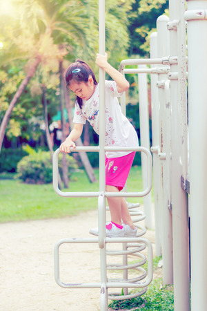 little asia girl child funny in playground Stock Photo