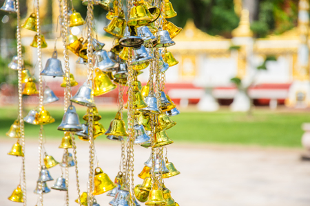 small gold and silver bell in the temple