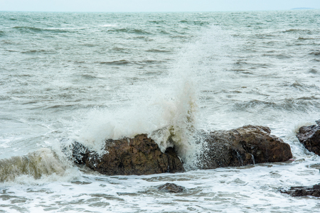 white sea waves hit the rocks nateral seascape
