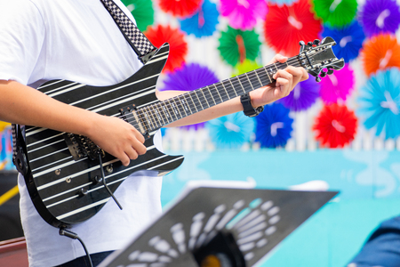 close up hand a man playing solo electronic guitar Stock Photo