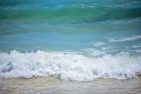 Sea wave foam on Karon beach, Phuket, Thailand. Exotic paradise of Thailand beach, Asia