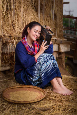 thai female in the rice field and cottage concept farmer lifestyle activity Standard-Bild