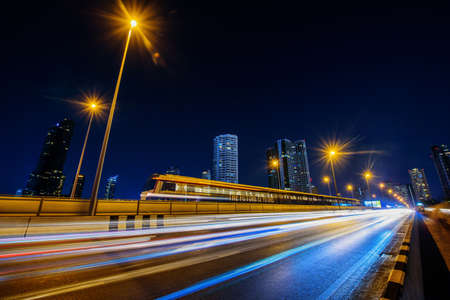 Blur light of car moving at road in night time / Long exposure shutter speed of car moving in road Standard-Bild
