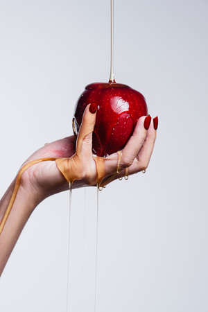 A woman holding a red apple and water running through  healthy concept