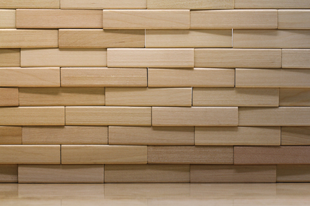 Wooden brick wall made from wood blocks under sunlight for background and wallpaper Imagens