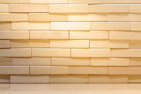 Wooden brick wall made from wood blocks under sunlight for background and wallpaper