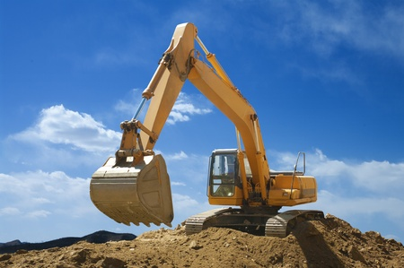 Large-sized excavator in mine work Stock Photo