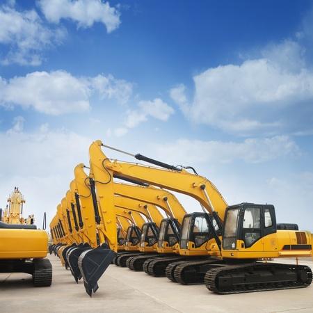 shiny and modern yellow excavator machines 写真素材