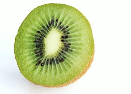 Single half of green kiwi fruit on isolated white background photo