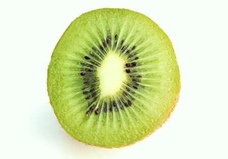 Single half juicy kiwi fruit still in skin photo