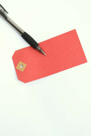 notelet: Black ink pen and red old fashioned parcel label