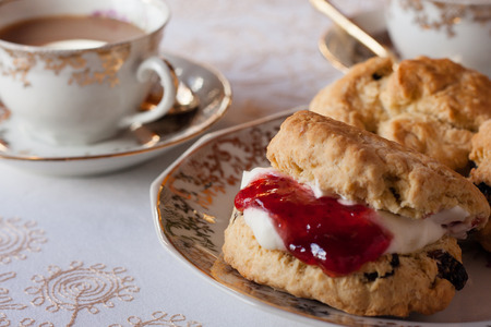 Afternoon tea with cream scone on fine china