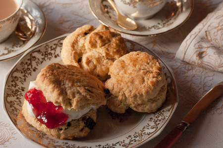 fine china: Afternoon tea with cream scone on fine china
